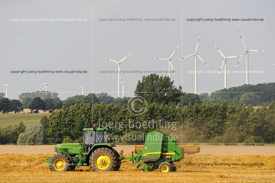 Deutschland Plauerhagen , John Deere Strohballenpresse und ENO Windturbinen im Windpark der MVV Energie Stadtwerke Mannheim / .Germany, John deere tractor with straw press machine and wind turbine of
