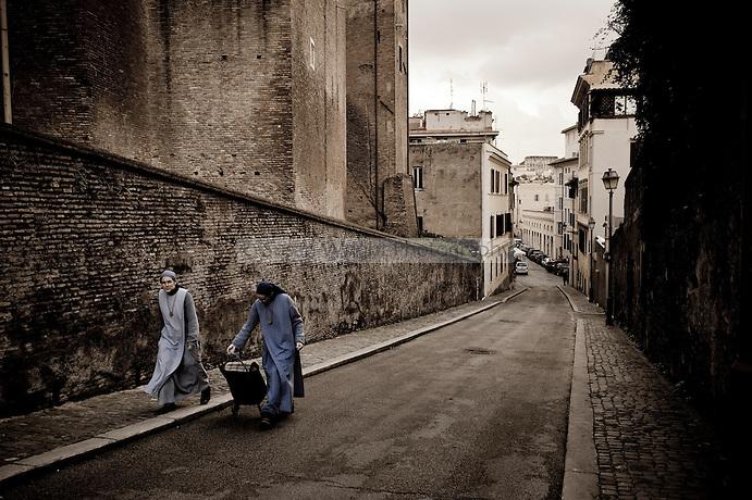 Nuns walking in a street in Celio, Rome, Italy