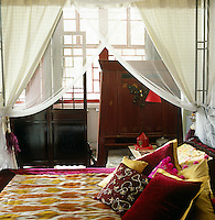 The bedspread in the master bedroom is made of ikat-style silk and came from the west of China where Jehanne's design was hand-woven on small looms