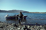 Inuit fishermen at summer Arctic Char camp, Baffin Island, Canada