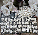 A man selling peeled cassava in a market near Thyolo, in southern Malawi.