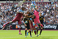 Ederson jumps and catches a cross during West Ham United vs Manchester City, Premier League Football at The London Stadium on 10th August 2019