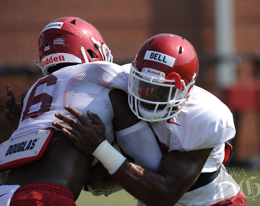 NWA Democrat-Gazette/ANDY SHUPE<br /> Arkansas defensive lineman Jamario Bell (right) wraps up Gabe Richardson Tuesday, Aug. 6, 2019, during practice at the university practice field. Visit nwadg.com/photos to see more photographs from the practice.