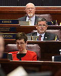 Nevada Assembly members, from top, Randy Kirner, R-Reno, James Oscarson, R-Pahrump, and Heidi Swank, D-Las Vegas, work on the Assembly floor at the Legislative Building in Carson City, Nev., on Monday, April 15, 2013. Both houses processed dozens of bills following Friday's major bill deadline. (AP Photo/Cathleen Allison)