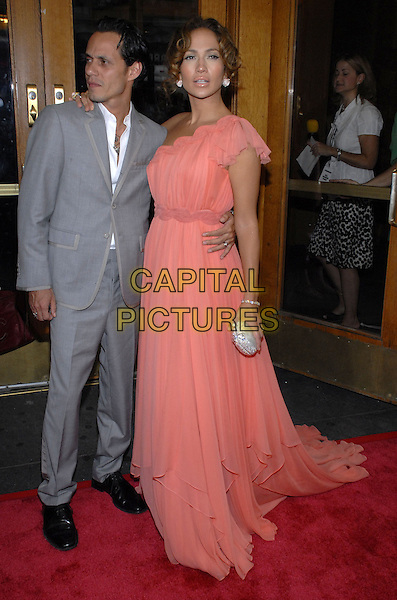 "MARC ANTHONY & JENNIFER LOPEZ.Picturehouse presents the New York premiere of ""El Cantante"" at AMC Thearter on 42nd Street, New York City, New York, USA..July 26th, 2007.full length grey gray suit one shoulder pink coral dress married husband wife arm around waist silver clutch purse  .CAP/ADM/BL.©Bill Lyons/AdMedia/Capital Pictures *** Local Caption ***"
