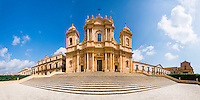 Panoramic photo of St Nicholas Cathedral (Noto Cathedral, Cattedrale di Noto) and Basilica San Salvatore from the steps of the Duomo, Noto, Sicily, Italy, Europe. This is a panoramic photo of St Nicholas Cathedral (Noto Cathedral, Cattedrale di Noto) and Basilica San Salvatore from the steps of the Duomo, Noto, Sicily, Italy, Europe.