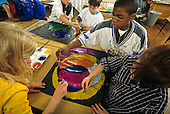 MR / Schenectady, New York. Yates Arts Magnet School, 3rd grade. Students paint during art class, some working cooperatively on the same painting. MR: LC-g3h ©Ellen B. Senisi