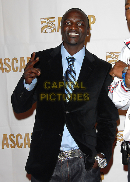 AKON.attends The ASCAP Rhythm & Soul Awards 20th Anniversary held at The Millenium Biltmore Hotel in Los Angeles, California, USA, June 25 2007.                                     half length blue striped tie shirt suit jacket hand peace sign gesture.CAP/DVS.©Debbie VanStory/Capital Pictures