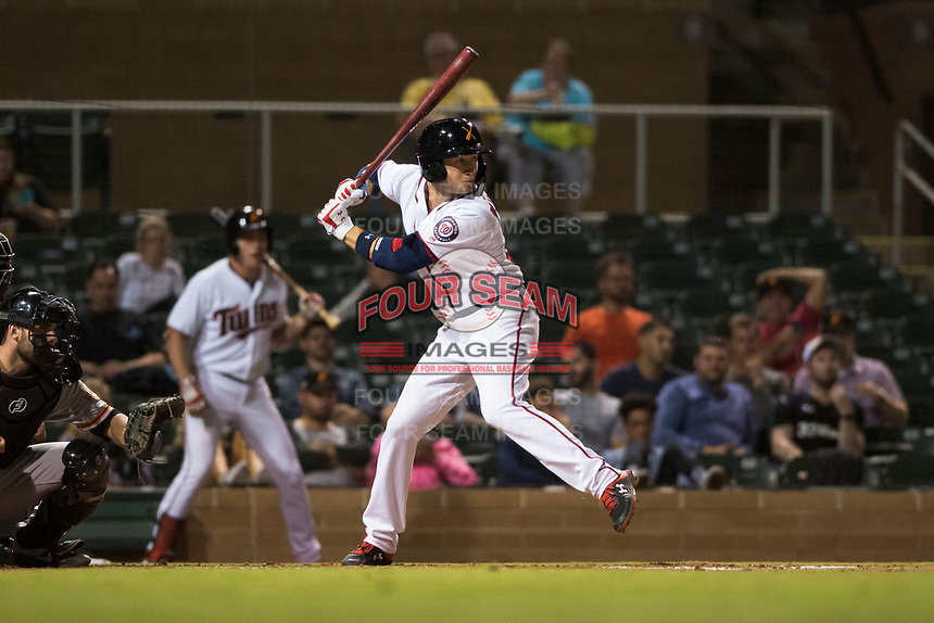 Salt River Rafters second baseman Carter Kieboom (24), of the Washington Nationals organization, at bat in front of catcher Matt Winn (16) during an Arizona Fall League game against the Scottsdale Scorpions at Salt River Fields at Talking Stick on October 11, 2018 in Scottsdale, Arizona. Salt River defeated Scottsdale 7-6. (Zachary Lucy/Four Seam Images)