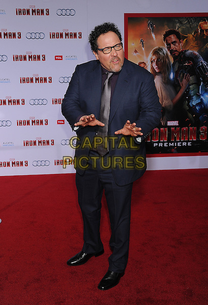 "Jon Favreau.The Los Angeles Premiere of ""Iron Man 3"" at El Capitan Theatre in Hollywood, California, USA..April 24th, 2013.full length blue suit purple shirt tie glasses goatee facial hair mouth open hands arms .CAP/ROT/TM.©Tony Michaels/Roth Stock/Capital Pictures"