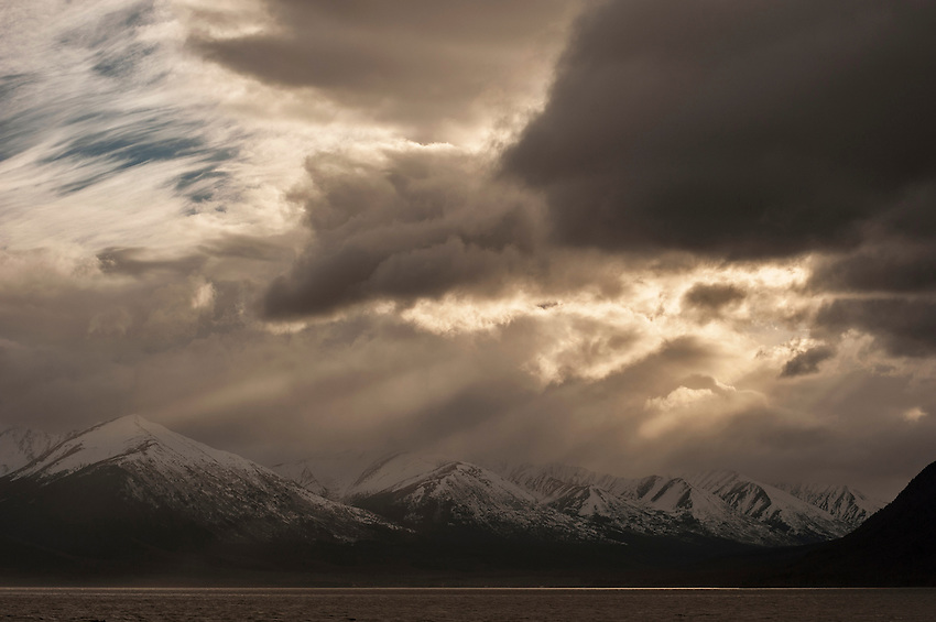 Breaking clouds over the Kenai Mountains and Turnagain Arm.