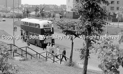 Bus stop, Wester Hailes, Scotland, 1979.  John Walmsley was Photographer in Residence at the Education Centre for three weeks in 1979.  The Education Centre was, at the time, Scotland's largest purpose built community High School open all day every day for all ages from primary to adults.  The town of Wester Hailes, a few miles to the south west of Edinburgh, was built in the early 1970s mostly of blocks of flats and high rises.