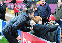 Lincoln City manager Danny Cowley poses for selfies with Lincoln City fans during the pre-match warm-up<br /> <br /> Photographer Andrew Vaughan/CameraSport<br /> <br /> The Emirates FA Cup Second Round - Lincoln City v Carlisle United - Saturday 1st December 2018 - Sincil Bank - Lincoln<br />  <br /> World Copyright © 2018 CameraSport. All rights reserved. 43 Linden Ave. Countesthorpe. Leicester. England. LE8 5PG - Tel: +44 (0) 116 277 4147 - admin@camerasport.com - www.camerasport.com