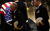 Members of the military pay their respects to President George H.W. Bush as they walk past the casket as he lies in state inside the Rotunda of the US Capitol, December 3, 2018 in Washington, DC. - The body of the late former President George H.W. Bush travelled from Houston to Washington, where he will lie in state at the US Capitol through Wednesday morning. Bush, who died on November 30, will return to Houston for his funeral on Thursday. (Photo by Brendan SMIALOWSKI / AFP)