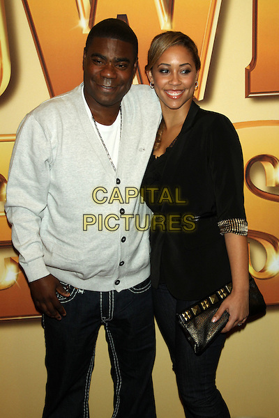 Tracy Morgan & Megan Wollover .'Tower Heist' New York Premiere, New York City, NY, USA..October 24th, 2011.half length black white cardigan blue jeans denim couple clutch bag.CAP/LNC/TOM.©TOM/LNC/Capital Pictures.