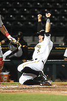 Bradenton Marauders third baseman Walker Gourley (5) throws his arms up as he slides in safely with the game winning run during a game against the Palm Beach Cardinals on April 8, 2014 at McKechnie Field in Bradenton, Florida.  Bradenton defeated Palm Beach 4-3.  (Mike Janes/Four Seam Images)