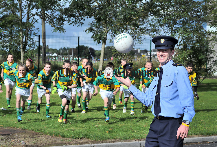 Garda Cyril Page with the Kilmihil football team at the Garda U-13 Football Tournament at St Flannan's College in Ennis. Photograph by Declan Monaghan