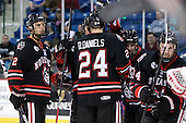 Drew Ellement (Northeastern - 2), Drew Daniels (Northeastern - 24), Wade MacLeod (Northeastern - 19), Steve Silva (Northeastern - 17) and Tyler McNeely (Northeastern - 94) celebrate McNeely's game opening goal midway through the second period. - The visiting Northeastern University Huskies defeated the University of Massachusetts-Lowell River Hawks 3-2 with 14 seconds remaining in overtime on Friday, February 11, 2011, at Tsongas Arena in Lowelll, Massachusetts.