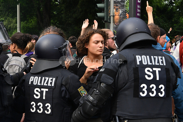 Police in riot gear and protestors scuffle during demonstrations against the G20 summit in Hamburg, Germany, 7 July 2017. The summit, a meeting of the governments of the twenty largest world economies, begins on the 7 July and concludes on the 8 July. Photo: Boris Roessler/dpa /MediaPunch ***FOR USA ONLY***