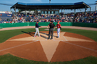 Batavia Muckdogs manager Tom Lawless (10) during the lineup exchange with Jose Leon (19) and umpires Tyler Witte (home), Jesse Busch (field) before a NY-Penn League game against the State College Spikes on July 3, 2019 at Dwyer Stadium in Batavia, New York.  State College defeated Batavia 6-4.  (Mike Janes/Four Seam Images)
