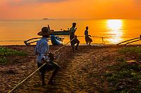 Fishermen haul in a fishing line at sunrise, Kinniya (near Trincomalee), Eastern Province, Sri Lanka.