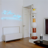 At the door to the family room Tracey Emin's 'I Dream of Sleep' and a totem and ceramic vase by Ettore Sottsass