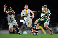 Chris Noakes of London Irish puts boot to ball as Matt Mullan of Wasps looks to charge him down. Aviva Premiership match, between London Irish and Wasps on November 28, 2015 at Twickenham Stadium in London, England. Photo by: Patrick Khachfe / JMP