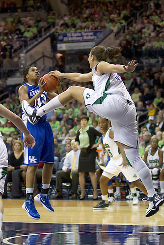 Notre Dame forward Natalie Achonwa (#11) blocks the ball as Kentucky guard Bria Goss (#13) goes up for a shot in first half action during NCAA Women's basketball game between Kentucky and Notre Dame.  The Notre Dame Fighting Irish defeated the Kentucky Wildcats 92-83 in game at Purcell Pavilion at the Joyce Center in South Bend, Indiana.