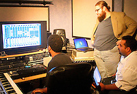 He checks out some beats at Crescendo Sound Studios with Sean Hunter and Peruvistan Longaray. Wesson creates his own sounds with software on his laptop.