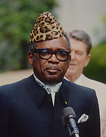 Washington DC., USA, September 23, 1984<br /> Mobutu Sese Seko President of Zaire with President Ronald Reagan standing behind delivers remarks on departure from the WHite House after meeting with Reagan in the Oval Office Credit: Mark Reinstein/MediaPunch