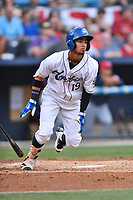 Asheville Tourists center fielder Manny Melendez (19) swings at a pitch during a game against the Charleston RiverDogs at McCormick Field on July 4, 2017 in Asheville, North Carolina. The Tourists defeated the RiverDogs 2-1. (Tony Farlow/Four Seam Images)