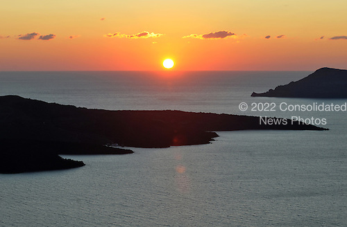 Sunset over the harbor from the top of the hill in Santorini, Greece on October 21, 2009..Credit: Ron Sachs / CNP