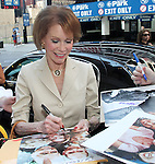 Mary Tyler Moore signing Autographs for fans as she arrives for Broadway Barks Lucky 13th Annual Adopt-a-thon Presentation in New York City.
