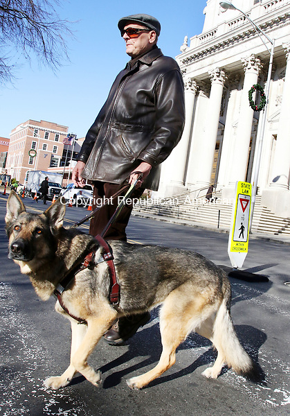 WATERBURY CT. 23 November 2015-112315SV04-Ross Kirk of Waterbury, who is blind, with his dog Zeva, tries to cross the street in a clearly marked crosswalk on West Main Street in Waterbury Monday.<br /> Steven Valenti Republican-American