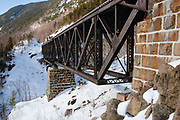 The Willey Brook Trestle along the old Maine Central Railroad in Hart's Location, New Hampshire during the winter months. This trestle is within Crawford Notch State Park. And since 1995 the Conway Scenic Railroad, which provides passenger excursion trains has been using the track.