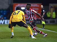 Lincoln City's Bernard Mensah vies for possession with  Wolverhampton Wanderers U21's Dominic Iorfa<br /> <br /> Photographer Andrew Vaughan/CameraSport<br /> <br /> The EFL Checkatrade Trophy Northern Group H - Lincoln City v Wolverhampton Wanderers U21 - Tuesday 6th November 2018 - Sincil Bank - Lincoln<br />  <br /> World Copyright © 2018 CameraSport. All rights reserved. 43 Linden Ave. Countesthorpe. Leicester. England. LE8 5PG - Tel: +44 (0) 116 277 4147 - admin@camerasport.com - www.camerasport.com