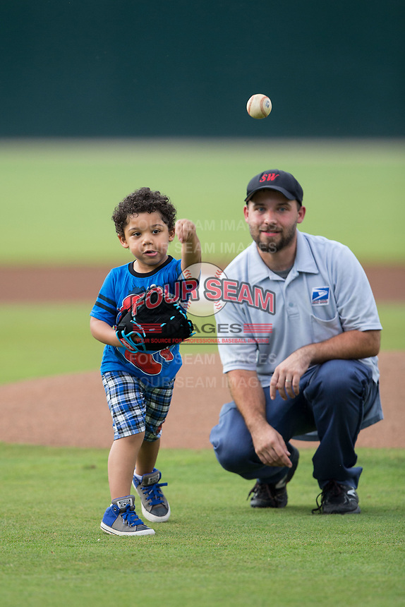 A young fan throws out a ceremonial first pitch prior to the South Atlantic League game between the West Virginia Power and the Kannapolis Intimidators at Kannapolis Intimidators Stadium on June 17, 2017 in Kannapolis, North Carolina.  The Power defeated the Intimidators 6-1.  (Brian Westerholt/Four Seam Images)