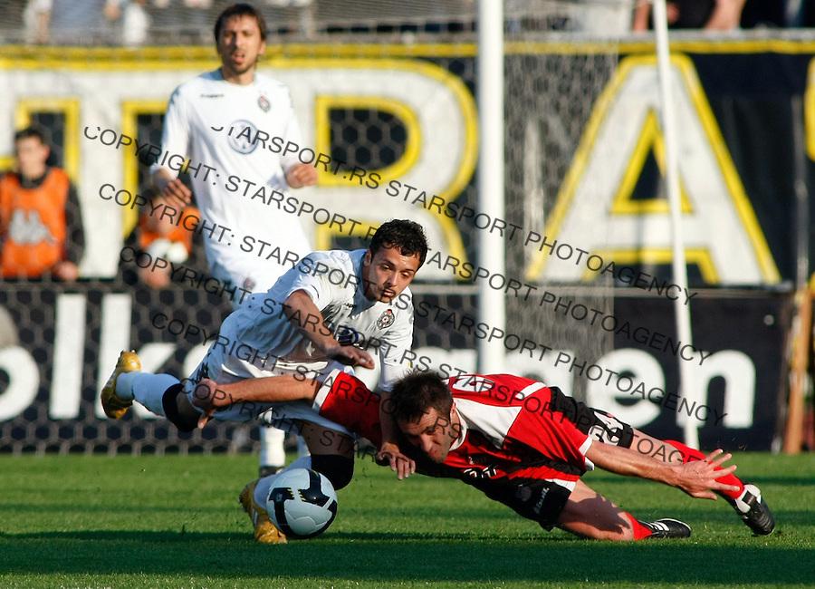 Fudbal, Jelen super liga, season 2008/09.Partizan Vs. Banat (Zrenjanin).Nikola Tomic, left and Sasa Stevic.Beograd, 04.04.2009..Photo: © Srdjan Stevanovic/Starsportphoto.com