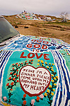 Hood of the jeep painted by Leonard Knight artist and creator of Salvation Mountain by the Slabs near Niland, Calif...Leonard Knight is a gentle and friendly man who is sharing his passion for God with all comers in the Imperial Valley...Bible verse: John 3:16--Love Bible Love