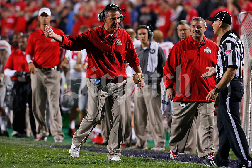 OSU coach Urban Meyer debates with a referee on the sidelines in the fourth quarter of their game at Ryan Field in Evanston, IL on October 5, 2013. Columbus Dispatch photo by Brooke LaValley)