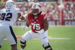 Wisconsin Badgers offensive lineman Micah Kapoi (75) during an NCAA College Football game against the Florida Atlantic Owls Saturday, September 9, 2017, in Madison, Wis. The Badgers won 31-14. (Photo by David Stluka)