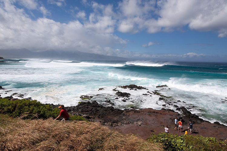 People gather to watch the huge surf at Ho'okipa on Maui
