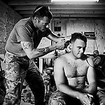 SFC Pakulak of 1 Platoon, Delta Co, 1-66, 4th Infantry Division, cuts hair at Combat Outpost TJ in the Arghandab Valley, Kandahar, 05 May 2011. (John D McHugh)