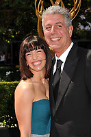 08 June  2018 -  Anthony Bourdain, the TV celebrity and food writer who hosted CNN's &quot; Parts Unknown,&quot; was found dead in his hotel room. File Photo: 12 September 2009 - Los Angeles, California - Anthony Bourdain (r) and wife Ottavia Busia. 61st Annual Creative Arts Emmy Awards held at Nokia Theatre LA Live. <br /> CAP/ADM<br /> &copy;Byron Purvis/ADM/Capital Pictures