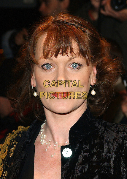 SAMANTHA BOND.The Awards of the London Film Critics Circle (ALFS), at the Dorchester Hotel, London, UK..February 8th, 2006.Ref: BEL.headshot portrait red lipstick pearl earrings.www.capitalpictures.com.sales@capitalpictures.com.© Capital Pictures.