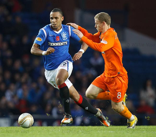 Kyle Bartley steps away from Scott Robertson