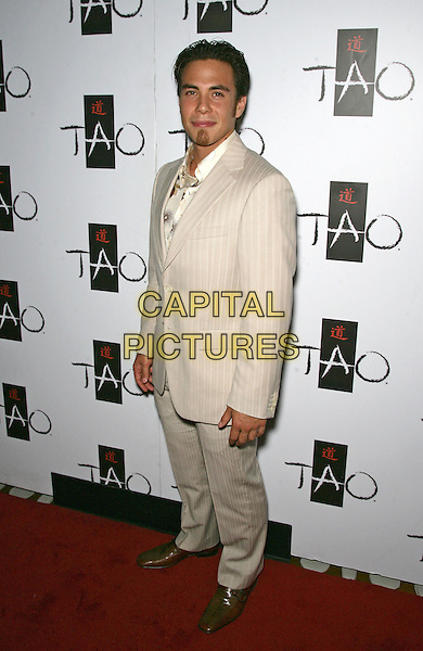 APOLO OHNO .celebrates his birthday at Tao Nightclub inside the Venetian Resort Hotel and Casino,  Las Vegas, Nevada, USA, .21st May 2010..full length beige cream pinstripe suit .CAP/ADM/MJT.© MJT/AdMedia/Capital Pictures.