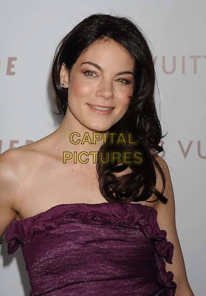 "MICHELLE MONAGHAN .Arriving at the Los Angeles premiere of ""Somewhere"" at ArcLight Cinemas, Hollywood, California, USA, .December 7th, 2010..portrait headshot  strapless purple ruched .CAP/ROT/TM.©Tony Michaels/Roth Stock/Capital Pictures"