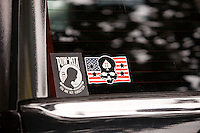Stickers in the rear window of a truck at my apartment complex in Houston (2016)