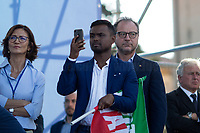 """(On the L) Mariastella Gelmini MP (Member of Parliament for Forza Italia, former Italian Minister of Education in the Berlusconi IV Government).<br /> <br /> Rome, 19/10/2019. Today, tens thousands of people (200,000 for the organisers, 50,000 for the police) gathered in Piazza San Giovanni to attend the national demonstration """"Orgoglio Italiano"""" (Italian Pride) of the far-right party Lega (League) of Matteo Salvini. The demonstration was supported by Silvio Berlusconi's party Forza Italia and Giorgia Meloni's party Fratelli d'Italia (Brothers of Italy, right-wing).  <br /> The aim of the rally was to protest against the Italian coalition Government (AKA Governo Conte II, Conte's Second Government, Governo Giallo-Rosso, 1.) lead by Professor Giuseppe Conte. The 66th Government of Italy is a coalition between Five Star Movement (M5S, 2.), Democratic Party (PD – Center Left, 3.), and Liberi e Uguali (LeU – Left, 4.), these last two parties replaced Lega / League as new members of a coalition based on Parliamentarian majority as stated in the Italian Constitution. The Governo Conte I (Conte's First Government, 5.) was 14-month-old when, between 8 and 9 of August 2019, collapsed after the Interior Minister Matteo Salvini withdrew his euroskeptic, anti-migrant, right-wing Lega / League (6.) from the populist coalition in a pindaric attempt (miserably failed) to trigger a snap election.<br /> <br /> Footnotes & Links:<br /> 1. http://bit.do/feK6N<br /> 2. http://bit.do/e7JLx<br /> 3. http://bit.do/e7JKy<br /> 4. http://bit.do/e7JMP<br /> 5. http://bit.do/e7JH7<br /> 6. http://bit.do/eE7Ey<br /> https://www.leganord.org<br /> http://bit.do/feK9X (Source, TheGuardian.com)<br /> Reportage: """"La Fabbrica Della Paura"""" (The Factory of Fear): http://bit.do/feLcy (Source Report, Rai.it - ITA)<br /> (Update) Reportage: """"La Fabbrica Social Della Paura"""" (The Social Network Factory of Fear): http://bit.do/fe8Pn (Source Report, Rai.it - ITA)"""